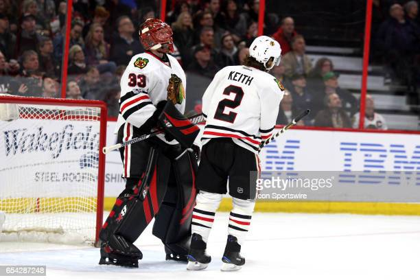 Ottawa Senators Defenceman Fredrik Claesson gets a tap on the pads from Chicago Blackhawks Defenceman Duncan Keith in the third period in a game...