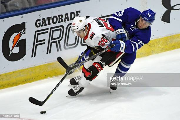 Ottawa Senators Defenceman Jordan Murray and Toronto Maple Leafs Forward Jean Dupuy fight for the puck during the NHL preseason Rookie Tournament...