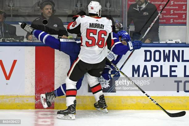 Ottawa Senators Defenceman Jordan Murray hits Toronto Maple Leafs Forward Jeremy Bracco during the NHL preseason Rookie Tournament game between the...