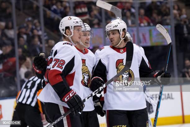 Ottawa Senators Defenceman Thomas Chabot celebrates after scoring his goal with Ottawa Senators Left Wing Ryan Dzingel and Ottawa Senators Left Wing...