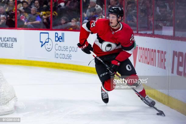 Ottawa Senators Defenceman Thomas Chabot skates the puck around the net during third period National Hockey League action between the Boston Bruins...
