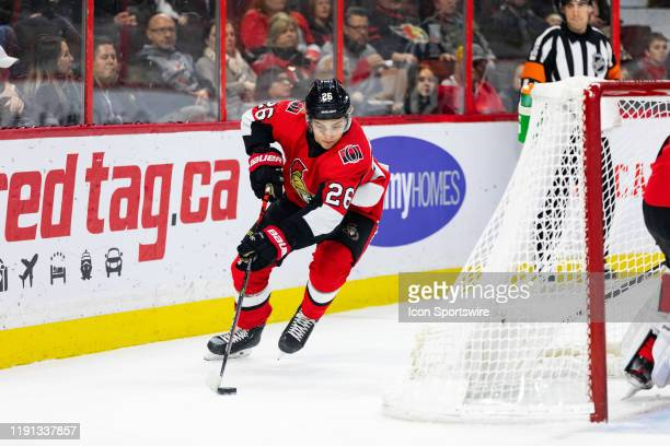 Ottawa Senators defenseman Erik Brannstrom skates the puck around the net during first period National Hockey League action between the Florida...