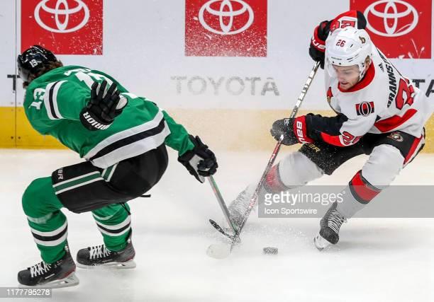 Ottawa Senators defenseman Erik Brannstrom tries to take the puck away from Dallas Stars center Mattias Janmark during the game between the Ottawa...