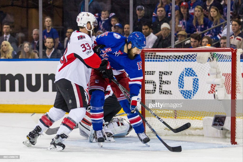 Ottawa Senators defenseman Fredrik Claesson (33) checks New York Rangers left wing Tanner Glass (15) in front of the net during the first period of game 6 of the second round of the 2017 Stanley Cup Playoffs between the Ottawa Senators and the New York Rangers on May 09, 2017, at Madison Square Garden in New York, NY.