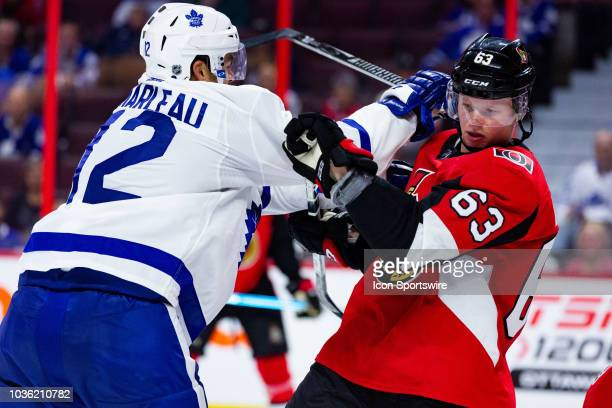 Ottawa Senators defenseman Julius Bergman battles with Toronto Maple Leafs center Patrick Marleau during third period National Hockey League...