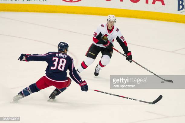 Ottawa Senators defenseman Thomas Chabot evades Columbus Blue Jackets center Boone Jenner in the first period of a game between the Columbus Blue...