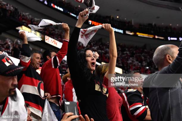 Ottawa Senators fans cheer at the end of the third period against the Pittsburgh Penguins in Game Three of the Eastern Conference Final during the...