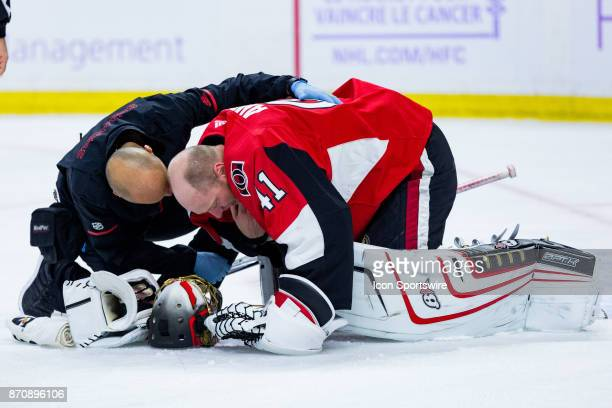Ottawa Senators Goalie Craig Anderson is checked on by Assistant athletic therapist Domenic Nicoletta during second period National Hockey League...