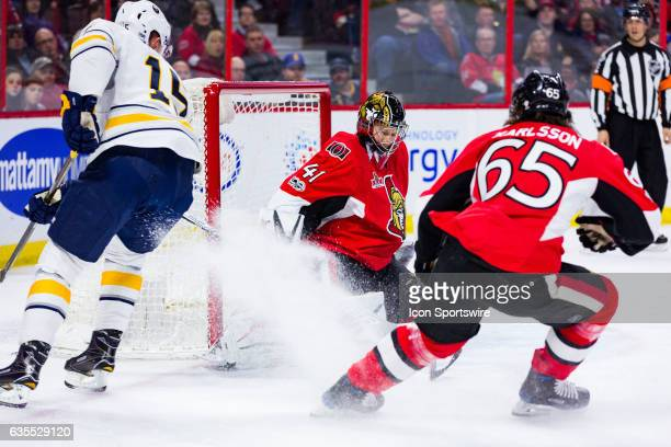 Ottawa Senators Goalie Craig Anderson make a pad save on Buffalo Sabres Center Jack Eichel as he receives a snow shower during first period National...