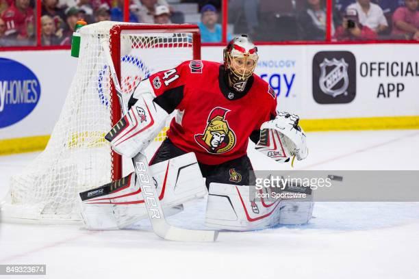 Ottawa Senators goalie Craig Anderson prepares to make a glove save during first period National Hockey League preseason action between the Toronto...