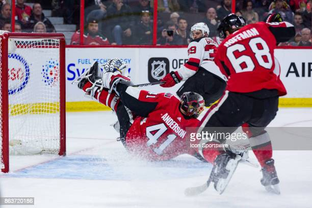 Ottawa Senators Goalie Craig Anderson slides across the crease in a two pad stack in the attempt to rob New Jersey Devils Winger Brian Gibbons during...