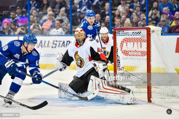 Ottawa Senators goalie Craig Anderson slides across the goal to cover the centering pass to Tampa Bay Lightning left wing Ondrej Palat during the...