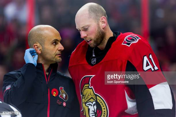 Ottawa Senators Goalie Craig Anderson talks to Assistant athletic therapist Domenic Nicoletta during second period National Hockey League action...