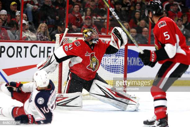 Ottawa Senators Goalie Craig Anderson with a glove save on Columbus Blue Jackets Center Alexander Wennberg during a game between the Columbus Blue...