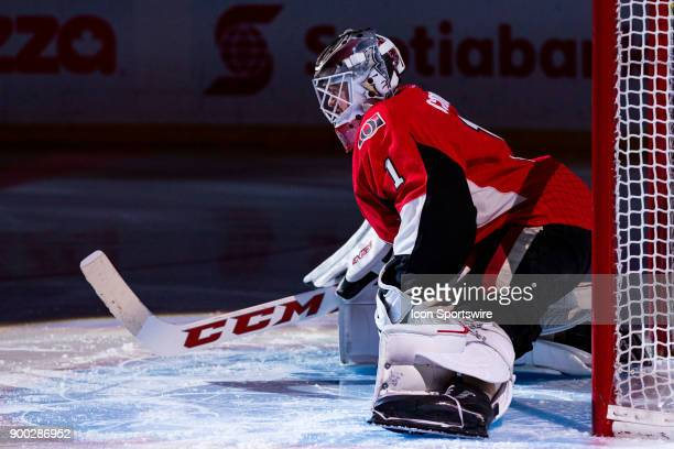 Ottawa Senators Goalie Mike Condon stretches in the spotlight as he's announced before National Hockey League action between the Boston Bruins and...