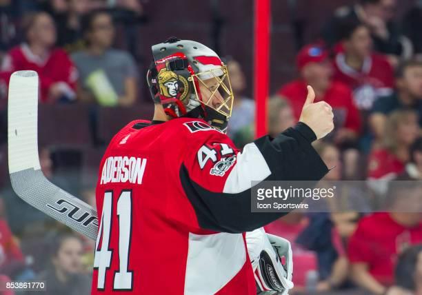 Ottawa Senators goaltender Craig Anderson gives a thumbs up during the NHL preseason game between the Ottawa Senators and the Montreal Canadians on...