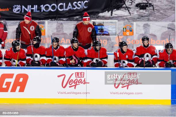 Ottawa Senators Head Coach Guy Boucher behind the bench during NHL 100 Classic first period National Hockey League action between the Montreal...