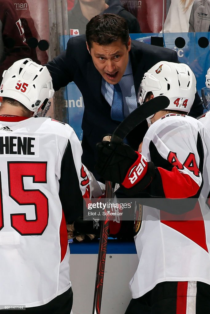 Ottawa Senators Head Coach Guy Boucher directs his team from the bench during a break in the action against the Florida Panthers at the BB&T Center on March 12, 2018 in Sunrise, Florida.