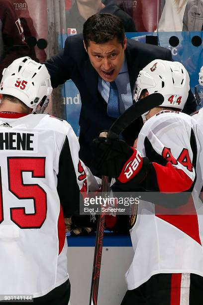 Ottawa Senators Head Coach Guy Boucher directs his team from the bench during a break in the action against the Florida Panthers at the BBT Center on...