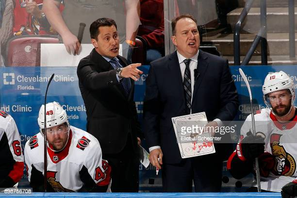 Ottawa Senators Head Coach Guy Boucher directs his team from the bench along with Martin Raymond Assistant coach during a break in the action against...