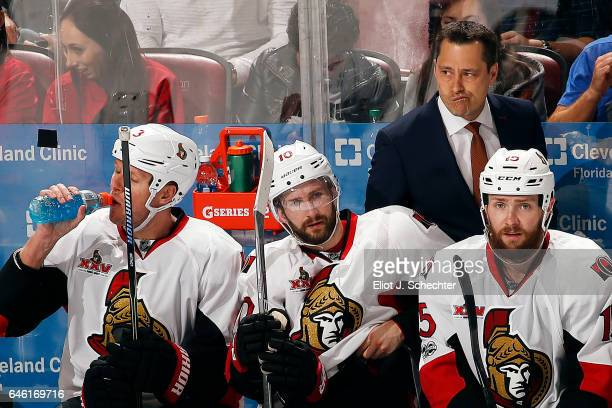 Ottawa Senators Head Coach Guy Boucher keeps an eye on the action from the bench against the Florida Panthers at the BBT Center on February 26 2017...