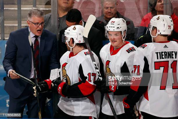 Ottawa Senators Head Coach Marc Crawford directs his team from the bench during a break in the action against the Florida Panthers at the BBT Center...