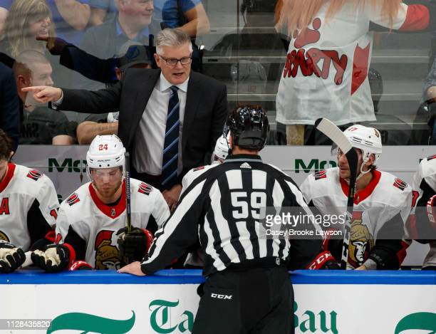 Ottawa Senators Head Coach Marc Crawford talks to linesman Steve Barton against the Tampa Bay Lightning at Amalie Arena on March 2 2019 in Tampa...