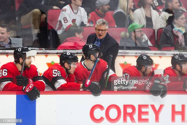 Ottawa Senators Interim Head Coach Marc Crawford yells on the bench during third period National Hockey League action between the New York Islanders...