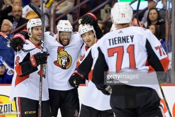 Ottawa Senators Left Wing Anthony Duclair is congratulated after scoring a goal against the Vancouver Canucks during their NHL game at Rogers Arena...