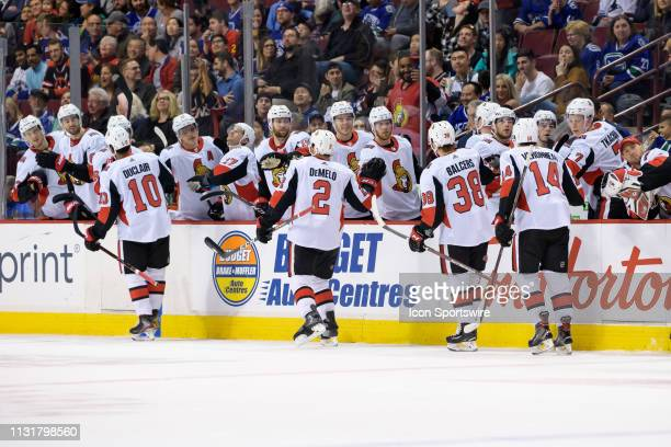 Ottawa Senators Left Wing Anthony Duclair is congratulated at the players bench after scoring a goal against the Vancouver Canucks during their NHL...