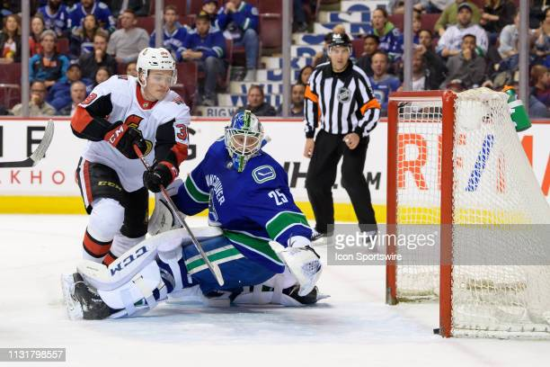 Ottawa Senators Left Wing Rudolfs Balcers watches a shot by Left Wing Anthony Duclair get past Vancouver Canucks Goaltender Jacob Markstrom during...