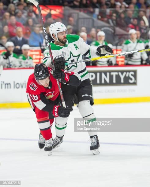 Ottawa Senators Left Wing Ryan Dzingel battles with Dallas Stars Right Wing Alexander Radulov centre ice during the second period of the NHL game...