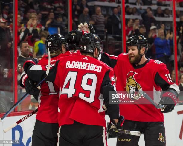 Ottawa Senators Left Wing Zack Smith celebrates the Senators second goal in the first period with Ottawa Senators Right Wing Christopher DiDomenico...