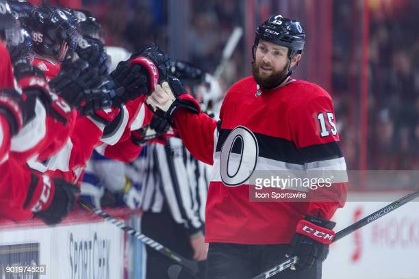 Ottawa Senators Left Wing Zack Smith skates by the bench to celebrate his goal during first period National Hockey League action between the Tampa...