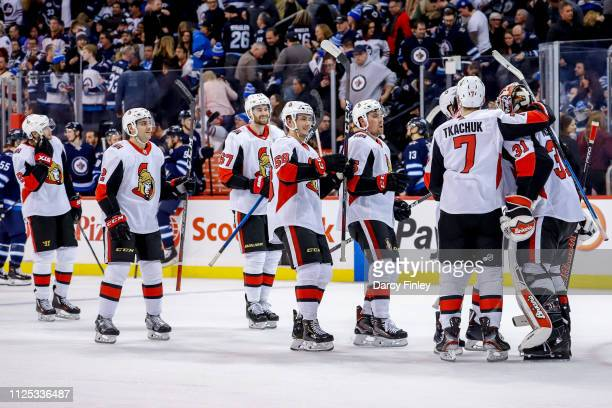 Ottawa Senators players congratulate goaltender Anders Nilsson following a 43 overtime victory over the Winnipeg Jets at the Bell MTS Place on...