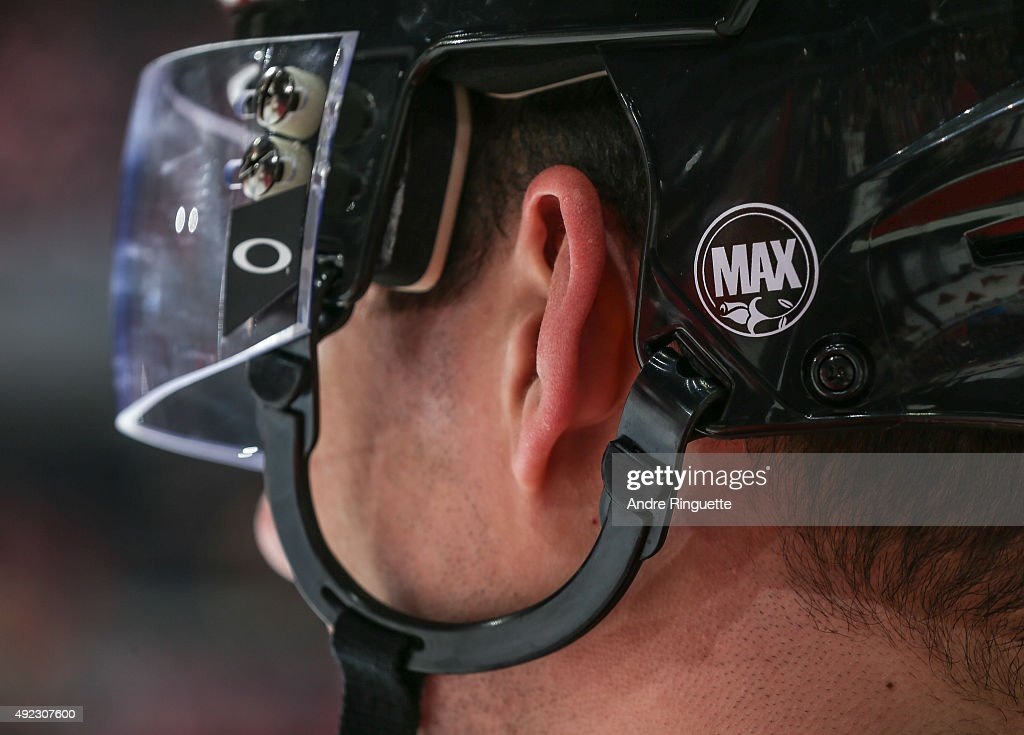 Ottawa Senators players wear decals on their helmets in honor of the passing of Max Keeping in a game against the Montreal Canadiens at Canadian Tire Centre on October 11, 2015 in Ottawa, Ontario, Canada.