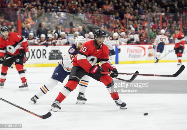 Ottawa Senators Right Wing Anthony Duclair and Edmonton Oilers Right Wing Josh Currie battle for the puck during the second period of the NHL game...