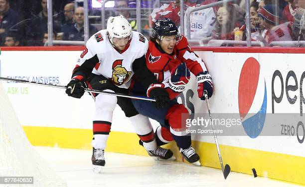 Ottawa Senators right wing Bobby Ryan checks Washington Capitals right wing TJ Oshie into the boards during a NHL game between the Washington...