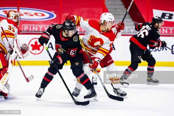 Ottawa Senators Right Wing Evgenii Dadonov battles Calgary Flames Defenceman Juuso Valimaki during second period National Hockey League action...