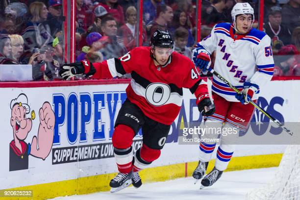 Ottawa Senators Right Wing Gabriel Dumont breaks away from New York Rangers Defenceman John Gilmour during first period National Hockey League action...