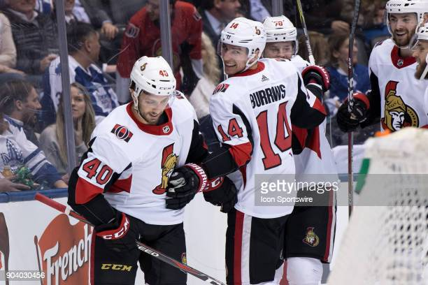Ottawa Senators Right Wing Gabriel Dumont celebrates after scoring his goal with Ottawa Senators Left Wing Alexandre Burrows and Ottawa Senators...