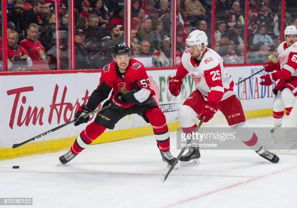 Ottawa Senators Right Wing Jack Rodewald stickhandles the puck in the first period against Detroit Red Wings Defenceman Mike Green during the NHL...