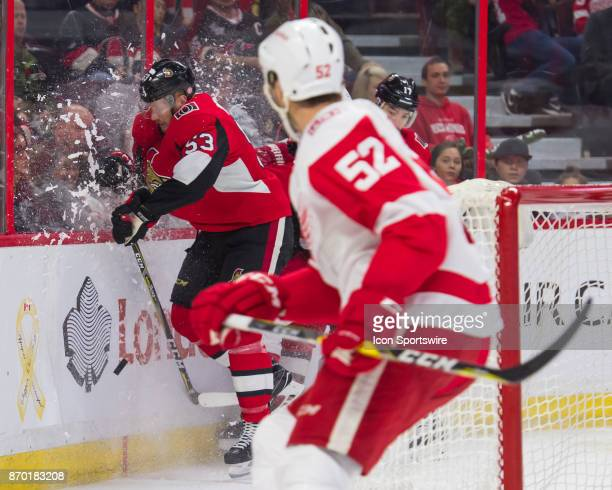Ottawa Senators Right Wing Jack Rodewald takes a hit against the boards as Detroit Red Wings Defenceman Jonathan Ericsson watches on in the third...