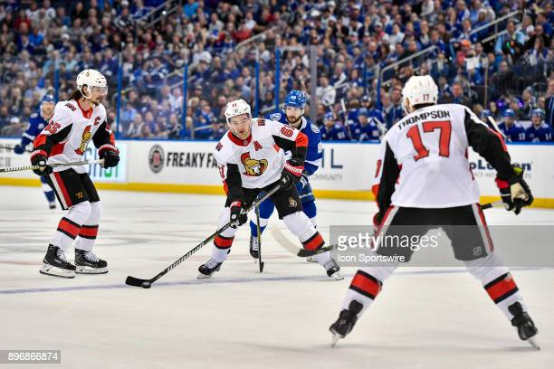 Ottawa Senators right Wing Mark Stone protects the puck from Tampa Bay Lightning right wing Nikita Kucherov during the third period of an NHL game...