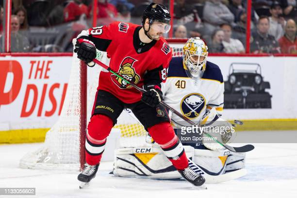 Ottawa Senators Right Wing Mikkel Boedker tips a shot in front of Buffalo Sabres Goalie Carter Hutton during first period National Hockey League...