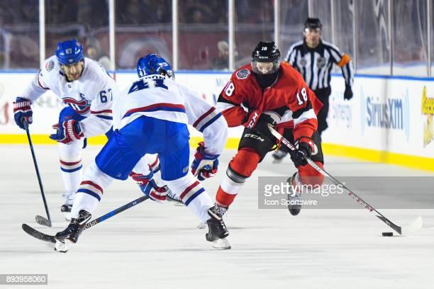 Ottawa Senators Right Wing Ryan Dzingel skates towards Montreal Canadiens Right Wing Paul Byron with the puck during the Montreal Canadiens versus...