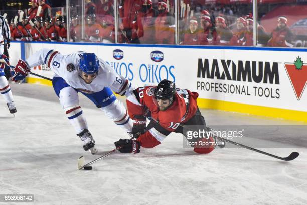 Ottawa Senators Winger Tom Pyatt reaches his stick while falling on the ice to gain control of the puck over Montreal Canadiens Defenceman Shea Weber...