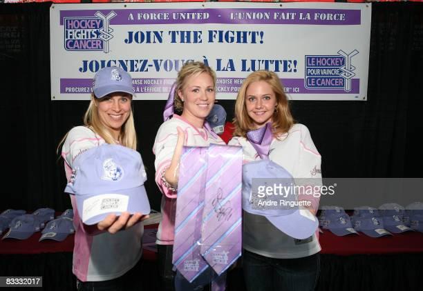 Ottawa Senators' wives and girlfriends Teresa Donovan Caitlin Neil Katie Perrault show off merchandise during Hockey Fights Cancer Awareness Night...