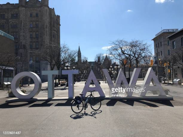 ottawa sign in the byward market is empty during the global pandemic, peace tower in the back ground - ottawa stock pictures, royalty-free photos & images