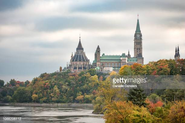 Ottawa's Parliament Buildings with colourful autumn leaves